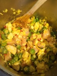 Okra, onion, pepper, tomatoes and chicken are sautéed in palm oil before a lengthy simmering with the palmnut soup base.