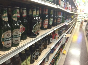 Beers from dozens of countries line the aisles at SW Portland's Johns Market.