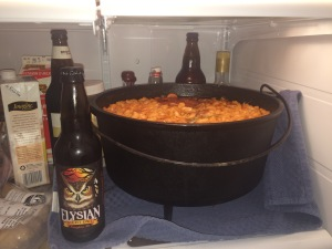 "Who looked at this big pot of pork and beans and said ""You know what this needs? Duck confit!"" (Beer bottles for scale)"