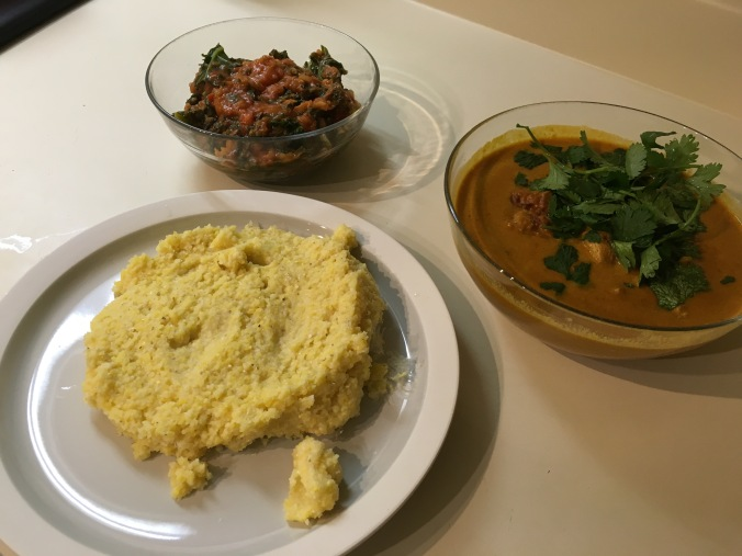 Clockwise from top: Sukuma wiki, kuku paka and ugali.